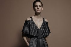 The cold shoulder felt — and looked — good for pre-fall, as designers showed shoulder-bearing ruffled tops and sleek gowns.