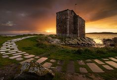 Portencross Castle, Ayrshire, Scotland by Peter Ribbeck. Believed to be the last mainland resting place for many former Scottish kings. Between the times of Cináed mac Ailpín (810-858) through to Máel Coluim mac Donnchada (1030/38-1093), the bodies of former kings were taken from Portencross and ferried to Iona for burial.