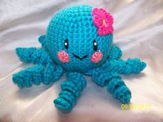 Floral the cute little crochet octopus with flower via Etsy