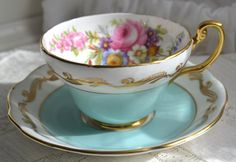 Foley teacup and saucer mixed floral aqua  blue gold scroll