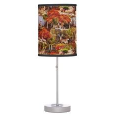 "Title : Cabin Lodge Forest Scene.JPG Table Lamp  Description : Rustic, ""Cabin-Lodge"", Animals, Wildlife, ""Accent-Pillows"", ""Log-Cabin"", ""Hunting-Lodge"", ""Fall-Season"", ""Tribal-Borders-Animal-Prints"", ""Black-Forest-Décor"", Whimsical, Ikat, ""Faux-Leather-Prints"", ""Native-American-Indian"", Tribal, ""Animal-Prints"", ""Western-Southwest-Prints"", Traditional, Modern, Bohemian, ""Country-Cottage"", Vintage, Kilim,  Product Description : <div>  Shade Material: Linen Shade    <div></div>  </div>"