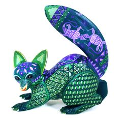 Efrain Fuentes, son of Epifanio Fuentes, created this stunning green op art fox.  This very nice wood carving is impressively painted!