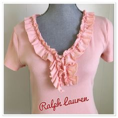 """Ralph Lauren ribbed top Ralph Lauren salmon colored ribbed top.  Cute Ruffles for the sweet feminine look. 100% cotton.  Lots of stretch! Approx measurements are underarm to underarm 18"""", underarm down 17"""", sleeves 6 1/2"""". It is a PETITE MEDIUM but I wear a normal medium and this fit me fine. Ralph Lauren Tops"""