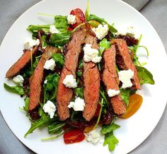 Tangy feta and Balsamic onions really take the steak. Get the Recipe: Grilled Skirt Steak Salad with Arugula, Balsamic- Glazed Onions, Tomatoes, and Feta   - Delish.com