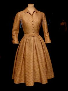 This is the dress that Grace wore for the engagement announcement, on Jan 5, 1956. There was a press conference at the Philadelphia Country Club. The dress was on display in Monaco exhibit. Because of the lighting it appears darker than engagement photo but it is the same dress.