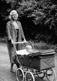 I'm sure we've all gone for a stroll wearing flip flops, a tiny bikini and a leopard skin coat. so Jayne Mansfield looks perfectly normal here while out with her son, Mickey Jr. Golden Family, Golden Age, Janes Mansfield, Muriel, Vintage Pram, Leopard Print Bikini, Leopard Dress, Old Movie Stars, Stars
