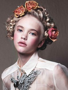 beautiful baroque and and romantic hairdo. braids and flowers...frida kahlo-ish