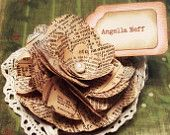 Place card holders with name tag. Vintage dictionary paper with pearl and vintage lace. 50 pcs.. $137.50, via Etsy.