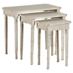 Showcasing a distressed hand-painted finish and scalloped aprons, this lovely nesting table set is the perfect addition to your living room or den. Use them ...