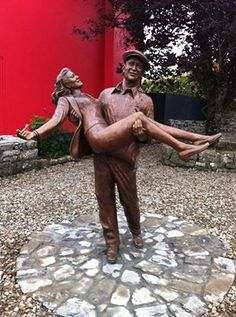 This Statue is dedicated to all those involved in the 1951 production of the film The Quiet man , filmed in Cong, Ireland. The statue depicts the characters of Sean Thornton and Mary Kate Danaher.