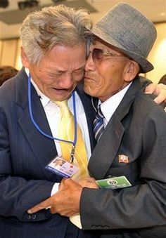 . these two men are brothers who have met for the first time after 50 years of separation from the korean war