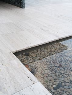 Water basin with natural stones. Barcelona Pavilion by Ludwig Mies van der Rohe. Photo by Alice Gao.