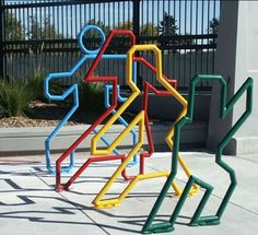 Kinda has a Keith Haring vibe going on, bike rack designed by the art team.