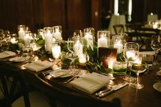 {{Spring wedding at the Chicago Athletic Association. Farm table garland and candles.}}  Flowers by Pollen, pollenfloraldesign.com ||  Photo by Katie Kett Photography, katiekettphotography.com