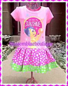 """I love the coordinating fabric skirt! This """"Your Are My Sunshine"""" t-shirt features Joy from the Disney