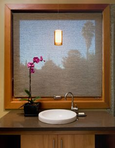 This opaque window treatment lets in light while providing visual screening.