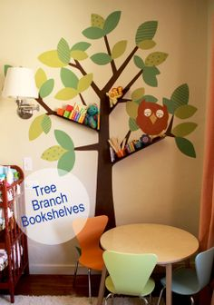 DIY tree branch bookshelves for baby / kids room: we have always loved this type of wall stickers as they are so easy to remove or update, but what a great way to take it a little futher by popping shelves on there too!