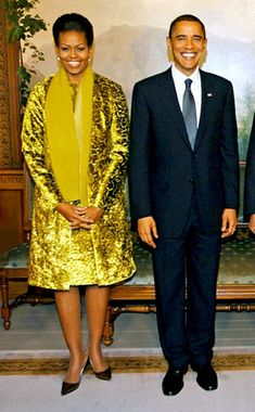 Golden Gal from Michelle Obama's Best Looks  Well, it is the holiday season, and there really isno better time to wear so much gold velvet.Shining in a Calvin Klein coat and dress ensemble, Michelleaccompanies her husband as he accepts his Nobel Peace Prize in Oslo, Norway.