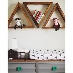 Iviebaby // black triangle changing pad cover. Love those shelves!