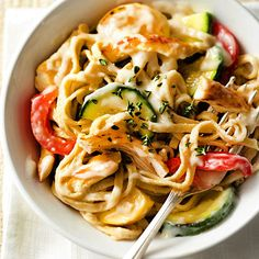 Refrigerated light Alfredo sauce makes pasta prep a cinch. Mix a medley of fresh veggies, chicken stir-fry strips, and whole wheat linguine in the creamy sauce for an irresistible quick and healthy dinner recipe.