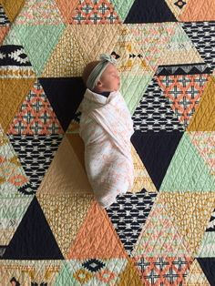 Triangle Baby Quilt   Diane Woodward   Little Bird Quilting. Made with Arizona by April Rhodes. Straight line quilting. #babyblanket