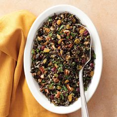 Wild rice marries with pecans and dried cranberries in an updated pilaf.