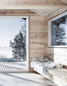 A cosy corner in Hytte Femunden, a cabin designed by Norwegian architect Aslak Haanshuus. Photo by Tom Gustavsen via Aslak Haanshuus Arkitekter. One Room Cabins, Cabins In The Woods, Ideas Cabaña, Scandinavian Cabin, Old Cabins, Log Cabin Homes, Barn Homes, Winter Cabin, Cabin Interiors