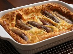 This classic Toad in the Hole recipe is spiced up with Cajun flavors and Andouille sausage. This is a toad in the hole with a Cajun twist. Toad In The Hole, Hot Dogs, Andouille Sausage Recipes, Great Recipes, Favorite Recipes, Top Recipes, Yummy Recipes, British Dishes