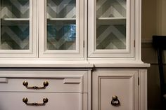 Thus vintage hutch makeover is amazing. Love that painted chevron backdrop inside the glass doors.