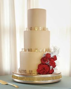 """Sugar peonies and the lyrics to """"Auld Lang Syne"""" decorate the carrot, lemon-blackberry, and chocolate-raspberry cake."""