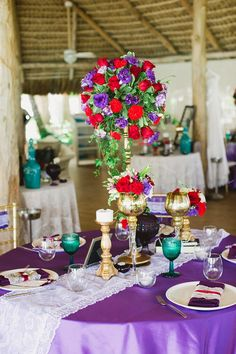 This tablescape is absolutely gorgeous! Love the purple tablecloth paired with gold, red & turquoise accents! #realwedding #destinationwedding  Katy Nova Photography: http://www.katyanovablog.com/