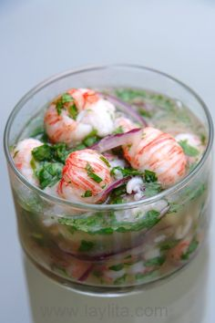 Langostino ceviche - This looks amazing!    2 lbs of cooked langostino meat, defrosted if frozen 1 red onion, cut in half and finely sliced lengthwise 12-15 limes, juiced 1-2 serrano peppers or other hot peppers, cut in half A few sprigs of cilantro + ½ bunch finely chopped 1-2 tbs olive oil 1 garlic clove, lightly crushed Salt to taste