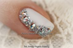 A touch of bling to razzle and dazzle a groom or set off a lovely ball gown. The Nail design is gorgeous with the white nail gilded along one side from the base to the tip with rhinestones and glitter. Funky Fingers Factory shows this and French and Diamonds can be mixed or used separately. - See more at: https://www.dailynails.com/nail-art?f[0]=field_theme:216#.dpuf