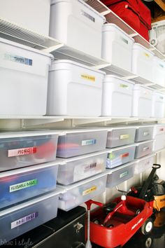 Organized and Pretty Garage with Container Store hanging Elfa shelves and drawers, and pretty paint swatch labels.