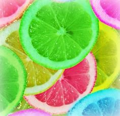 Rainbow refreshing lemon. Use food colouring in a bowl to soak your lemon / lime in and then freeze. They make very cool colourful ice cubes in drinks and punch. Rainbow Party Lemons. Awesome.