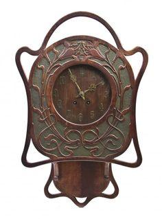 2538: An American Art Nouveau Oak Clock, Height 26 inch : Lot 2538