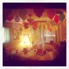 I did it!! For my husband's 38th birthday, I had 38 balloons in our room and attached to the bottoms were pictures of my husband at various points in his life (as well as a little love note from moi!). Fun and cheap gesture for a birthday gift! ive done something like this before, something to consider.