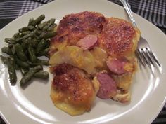 """""""Cheesy Potato's & Kielbasa Casserole""""    This is a very easy one dish casserole that your Family will love.  Great for Dinner or as a take along covered dish for a party.    Ingredients:  9x9 Glass Baking Dish,  4-6 Med to Lg Yukon Gold Potato's peeled & sliced,  14 oz. of Kielbasa,  4 cups Cheddar Cheese (white & yellow), some Parmesan & Mozzarella Cheese,  2-3 tbls butter cut into small cubes,  Onion Powder,  Flour     How To Webisode  http://youtu.be/xigpPtZxQ1Y"""
