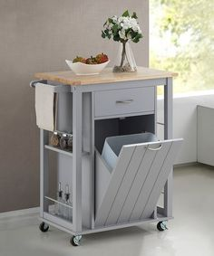 Masterfully mixing charm and functionality, this kitchen cart offers a wide variety of storage solutions and a handsome wood top for added flair. The rolling design makes transportation a breeze.