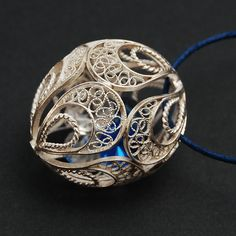 Filigree pendant with swarovski to hang where you want  (0,24 oz). $110.00, via Etsy.