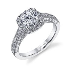 This vintage inspired, romantic engagement ring features a 1 carat round brilliant diamond set in a cushion halo with a shank of channeled diamonds and milgrained details for a total of carats. Vintage Inspired Engagement Rings, Antique Engagement Rings, Designer Engagement Rings, Engagement Ring Shapes, Halo Diamond Engagement Ring, Engagement Ideas, Thing 1, Anniversary Rings, Wedding Rings