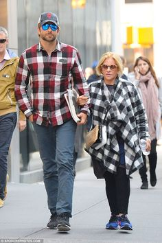 Check them out! Bradley Cooper cut a coordinated figure with his mother Gloria on Thursday...