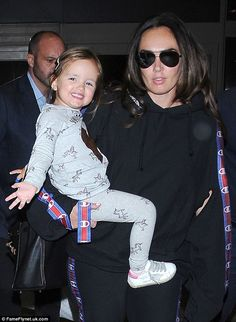 Look at that smiler! Sophia Ecclestone-Rutland, three, put on an adorably animated display as she touched down at LAX airport with her mum Tamara on Tuesday