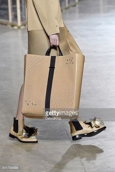 News Photo : Accessories bag detail on the runway at the...