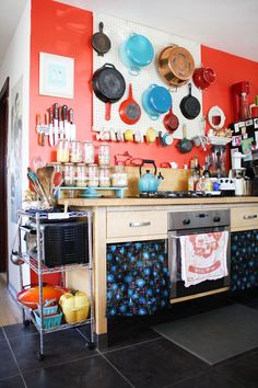 Kate Payne's Warm East Austin Home House Tour | Apartment Therapy  this much stuff would make me crazy, but I am happy to see a pegboard pot rack