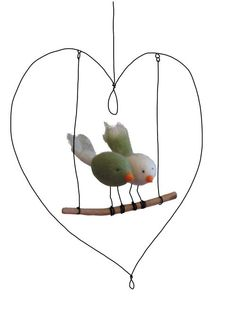 love the little loops in the heart that the swing hangs from - odile bailloeul