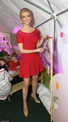 Feeling festive: Rachel Riley looked ready for Christmas in a pretty red dress as she open...