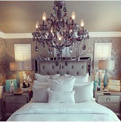 Transform your master suite into a romantic oasis with this stunning Celine six-piece king bedroom set. This silver bedroom set features a gorgeous tufted headboard with mirrored panels for an elegant