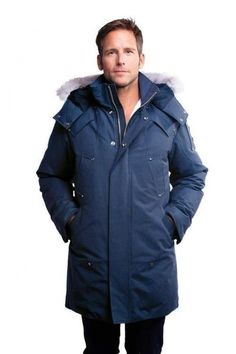 Shop this look for $28:  http://lookastic.com/men/looks/navy-parka-and-black-jeans/294  — Navy Parka  — Black Jeans