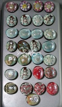 use scrap paper or whatever and the glass stones in the flower section of michaels magnets and adhesive voila!!!